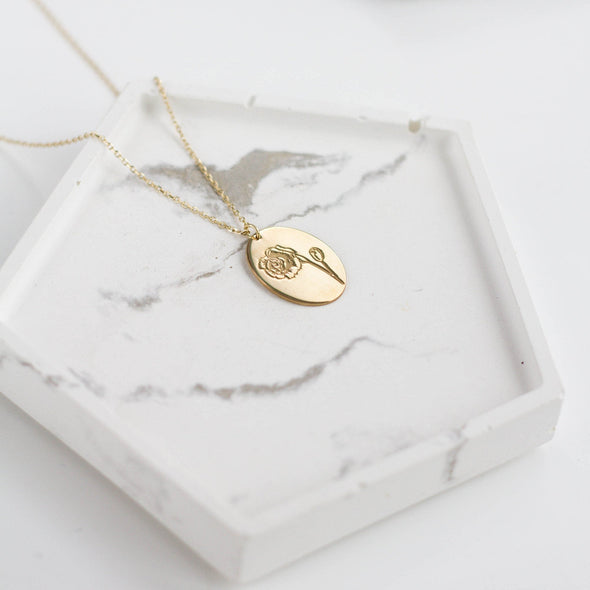 a gold birth flower necklace