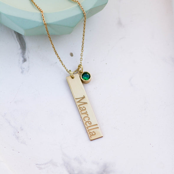 a vertical name necklace bar with a birthstone