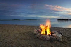 camp-fire-beside-lake-at-sunset-minnesota-usa-300x200