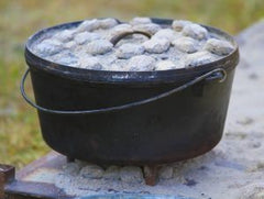 dutch-oven-cooking-with-coals-stock-image