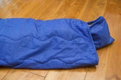 girl-in-sleeping-bag-for-camping-camping-equipment-300x200