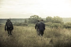 hunters-going-on-rural-field-at-sunrise-during-hunting-season-300x200
