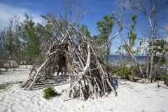 primitive-tepee-structure-built-on-the-beach-300x200