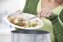 woman-scraping-food-leftovers-into-garbage-bin-300x200