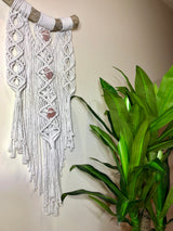 white macramè wall hanging with quartz crystals