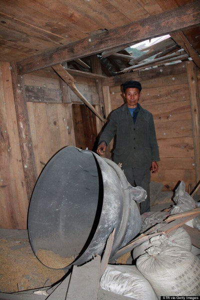 A resident of the village in China after the rocket debris fell.