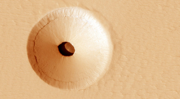 The Mars hole is situated at the bottom of a bowl like crater