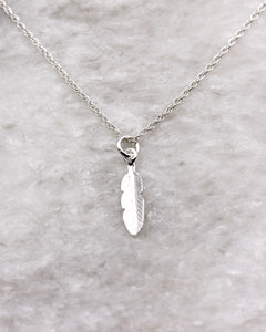 Silver choker necklace with small feather pendant