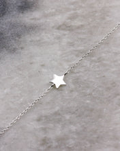 Silver star on a fine chain bracelet