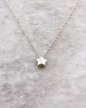 Small star pendant on choker necklace in silver