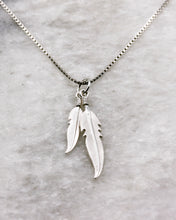 Feather pair pendant on chain in silver