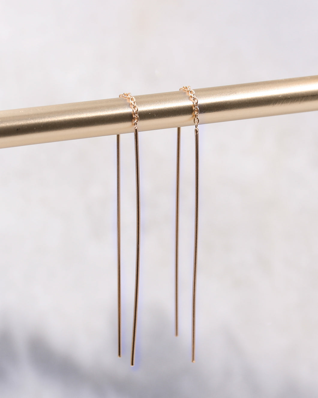 Delicate long fine bar earrings in rose gold