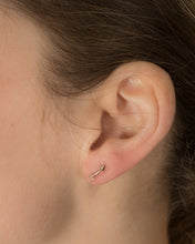 Model wearing arrow ear studs