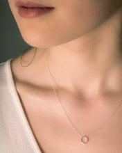 Model wearing geometric hexagon necklace in silver