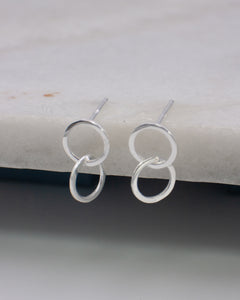 Small linked hoop ear studs in silver