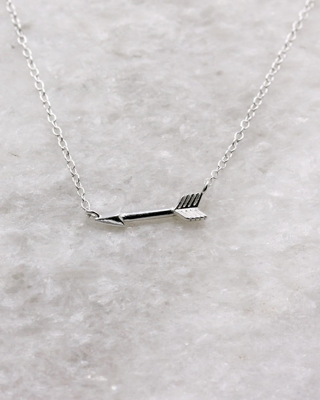 Shooting arrow on fine chain necklace in silver