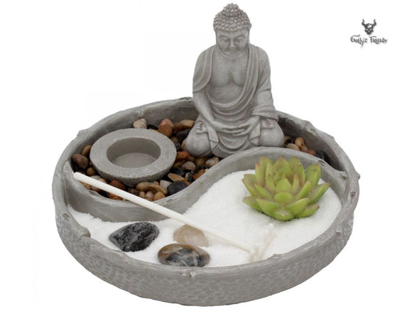 Buddha sits in deep meditation in Zen garden