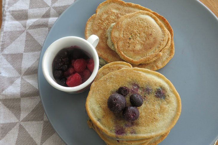 6 ingredient almond flour crumpets with frozen blueberries on the side