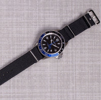 solid black nato strap with silver buckle