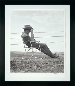 JAMES DEAN RESTING ON THE SET OF GIANT