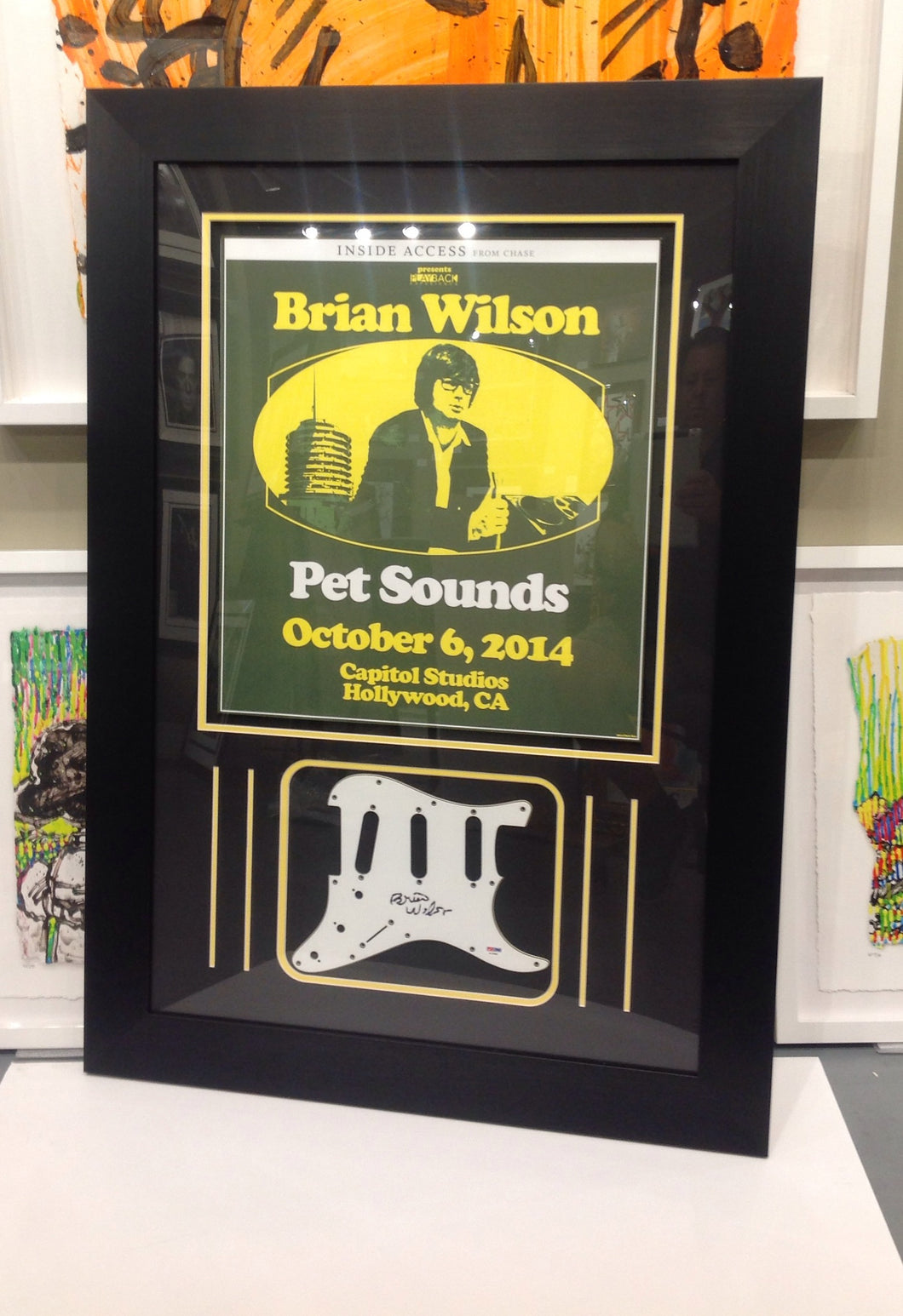 BRIAN WILSON SIGNED PICKGUARD WITH COMMEMORATIVE POSTER