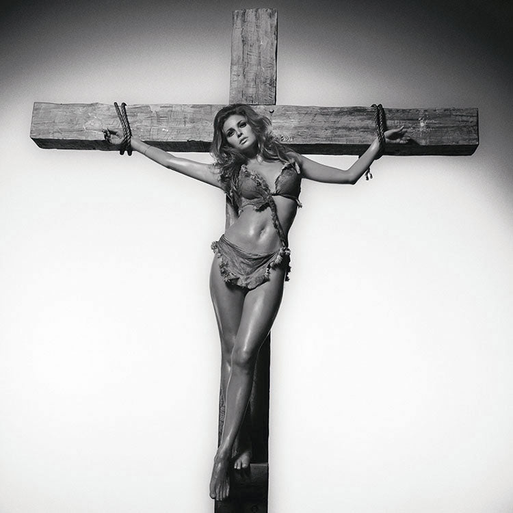 RAQUEL ON CROSS - HAND SIGNED BY RAQUEL WELCH