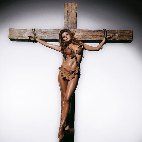RAQUEL ON CROSS - HAND-SIGNED BY TERRY O'NEILL