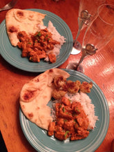 Delicious Chicken Tikka Masala dinner with rice and naan