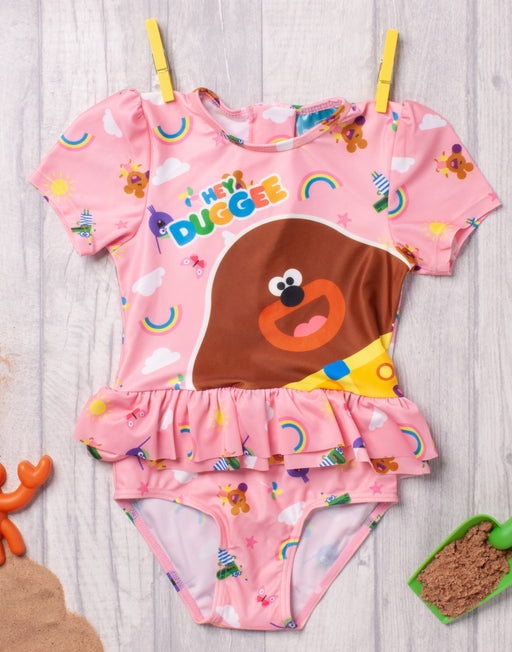 HEY DUGGEE PINK CHARACTER SUNSAFE SWIMSUIT - Our adorable girl's Hey Duggee swimsuit is perfect for little ones on their summer adventures, swimming and playing on pool and beach days with the Squirrel Club whilst keeping safe from the sun!