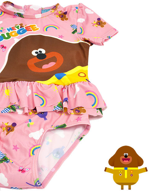 PINK HEY DUGGEE & FRIENDS SWIMSUIT SET FOR HER - Featuring the much-loved dog character Hey Duggee, the leader of The Squirrel Club contrasted against a vibrant pink swimsuit that showcases an all over print of Hey Duggee friend characters, suns and rainbows; this Hey Duggee swimming costume is adorable for toddlers and children!