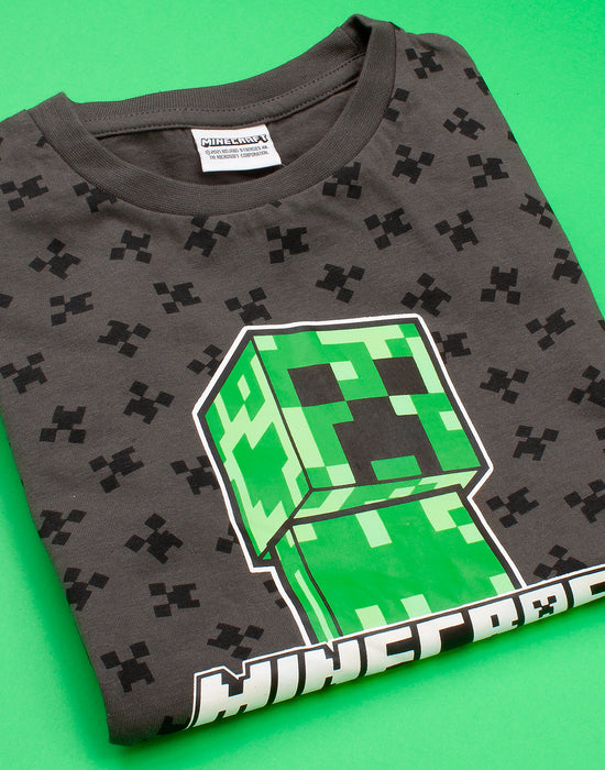 MINECRAFT CREEPER T SHIRT FOR CHILDREN & TEEN GAMERS - This awesome Minecraft t-shirt comes with shorts sleeves and a crew neck featuring the popular Mojang video games villain, the Creeper making a must have gift for gamers!
