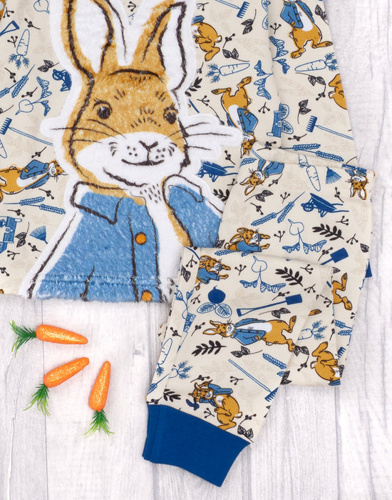 The top and bottoms feature a fluffy print showcasing Peter Rabbit surrounded by plants and carrots making a must have nightwear gift set for babies, toddlers and children!