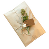 Eco-friendly natural Kraft paper gift wrapping with jute cord, handmade charms and recycled paper gift tag