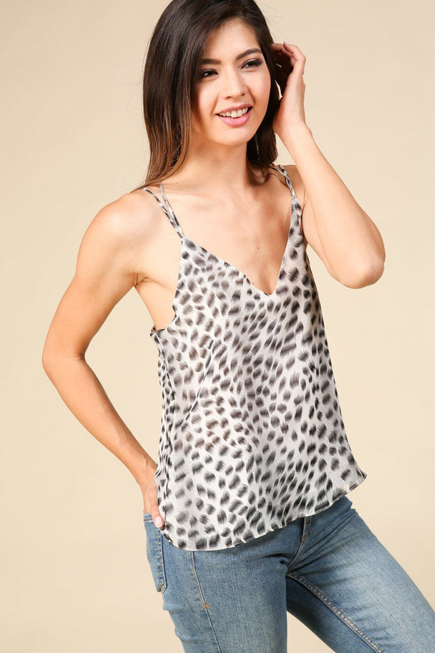 Floral print open-shoulder top featuring brass ring detail at halter neckline