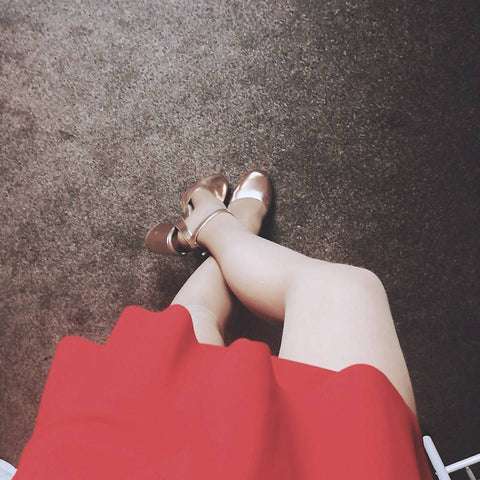 christmas party outfit with red mini skirt and shinny gold metallic high heels