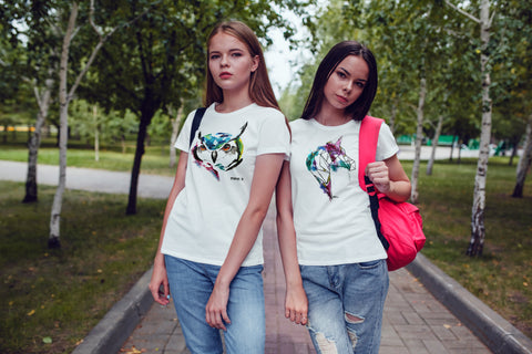 Girls wearing hand painted owl T-shirt and hand painted unicorn T-shirt