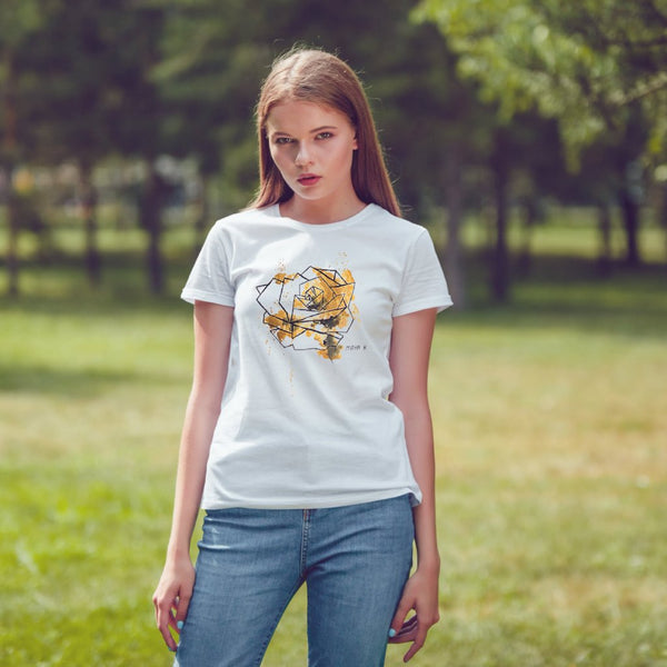 girl with gold geometric rose t-shirt in the forest under the sun