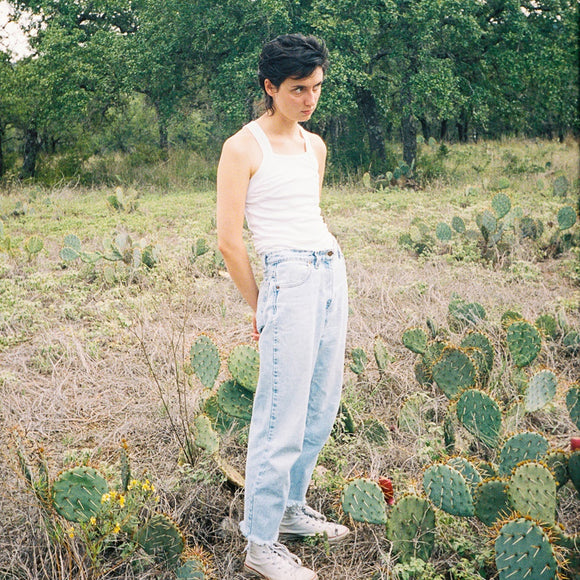 Cool Dry Places by Katy Kirby on Keeled Scales Records (the album title is  a colour photograph of Katy Kirby stood in a meadow among cacti; they wear light blue jeans and a white vest and glare off camera; behind them are trees)