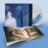 CD edition of Banane Bleue by Frànçois & The Atlas Mountains on Domino Records with booklet (the album sleeve is a photograph of Frànçois Marry superimposed over a photograph of a telegraph pole against a blue sky with light clouds; blue bananas emanate from the top of the telegraph pole lie radio waves)