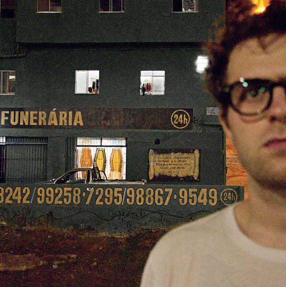 Palindrome by Ghost Bag on Adagio830 (the album cover is a colour photograph of Nick Jongen stood outside a building that houses a funeral home)