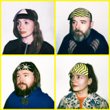 Band photographs of Hen Ogledd (the image is made up of four square images, each showing a band member against a plain white background staring off camera. Each band member, Dawn Bothwell, Rhodri Davies, Richard Dawson and Sally Pilkington, wears a homemade-looking patterned head-dress)