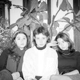 Black and white photgraph of Penelope Lowenstein, Nora Cheng and Gigi Reece of Horsegirl