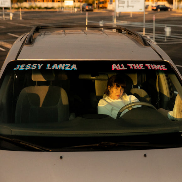 All The Time by Jessy Lanza on Hyperdub Records (the album cover shows Jessy Lanza sat in the drivers' seat of a car, facing the camera through the windshield; their left foot rests on the dashboard, and the car is parked in a outdoor carpark; the only other cars are far in the background; across the top of the windshield is the artist name and album title)
