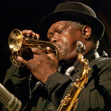 Photograph of Joe McPhee playing a pocket trumpet