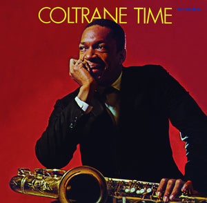 Coltrane Time by John Coltrane on Essential Jazz Classics (the album cover is a colour photograph of John Coltrane with a saxophone on his knee and his chin in his hand, looking off camera smiling).