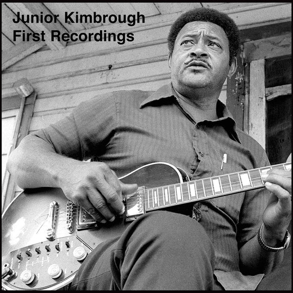 First Recordings by Junior Kimbrough on Big Legal Mess Records (the album cover is a black and white photograph of Junior Kimbrough on a porch playing an electric guitar and looking off camera).