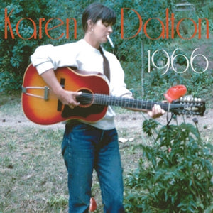 1966 by Karen Dalton on Delmore Recording Society (the album cover is a colour photograph of Karen Dalton stood outdoors next to a bush with a single red flower growing from it; Dalton holds a 12-string acoustic guitar, which shw appears to be playing; she has a large cigarette in her mouth and does not look at he camera. The artist name and album title appear in a large round light font)
