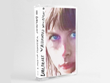 Cassette version of Aquainted With Night by Lael Neale on Sub Pop Records (the album sleeve shows a close up grainy photograph of a sunlit Lael Neale looking at the camera with blue eyes; the artist name and album title is hand-written along the left edge)