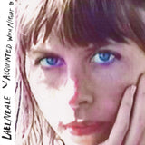 Aquainted With Night by Lael Neale on Sub Pop Records (the album sleeve shows a close up grainy photograph of a sunlit Lael Neale looking at the camera with blue eyes; the artist name and album title is hand-written along the left edge)