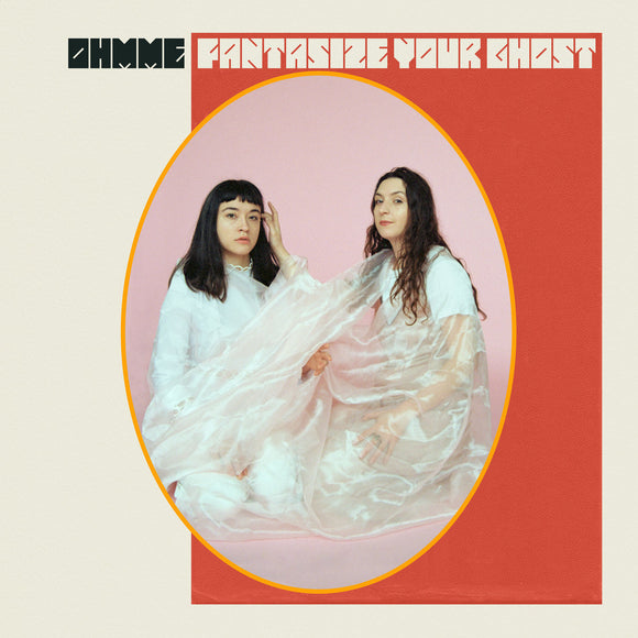 Fantasize Your Ghost by Ohmme on Joyful Noise Recordings (the album cover depicts and oval photograph of band members, Sima Cunningham and Macie Stewart, dressed in white and kneeling against a pink background wrapped in a stain cloth; the band name and title are in a stylised font across the top of the sleeve, which is white with a large red rectangle, intersected by the oval photograph)
